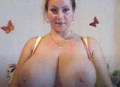 Chesty Blonde Licking Nipples